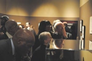 """Visitors viewing the """"Without Sanctuary"""" exhibition at the National Underground Railroad Freedom Center. Photograph by Thadd Fiala"""