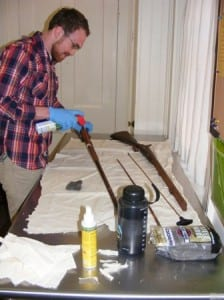 Dennis Shay, Fairfield Heritage Association intern, cleans a historic firearm. collection