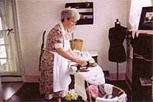 A costumed interpreter plays the role of John Glenn's mother.