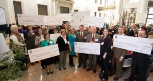History Fund grant awardees posing with oversized checks.