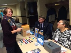 Ruth Brindle, Andy Verhoff, and Rosa Rojas at registration table before Awards Luncheon, 2015